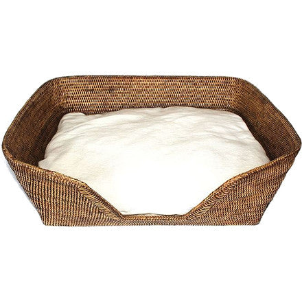 Antique Brown woven rattan dog bed with cushion.