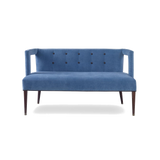 Modern loveseat with tufted back and angular, cutout arms.