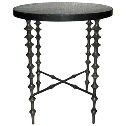 Oly Studio Ichibad antiqued bronze cast iron base side table with turned legs supporting a round dark shell top.