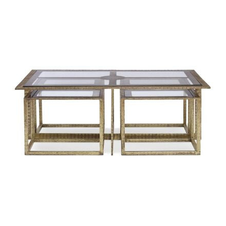 Hammered armour gold coffee table with glass top, champagne border and 4 nesting tables.