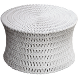 White Cast resin is formed into a drum shape and then shaped and pierced to resemble rows and rows of rippling ribbon.
