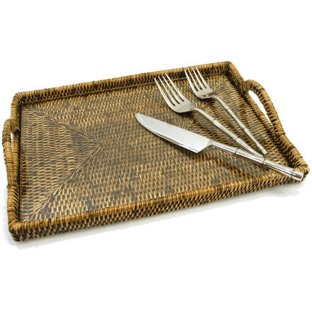 Small antique brown woven rattan tray with a glass inset and handles.