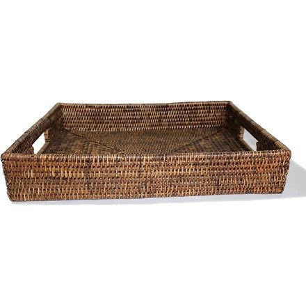 Small rectangular antique brown woven rattan tray with cutout handles.