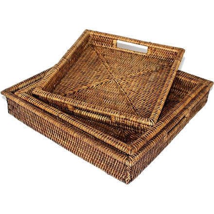 Set of three antique brown woven rattan square nested trays with handles.