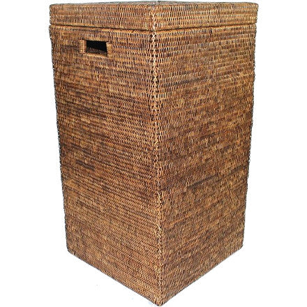 Antique brown square woven rattan laundry hamper with cutout handles and a lid.