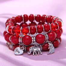Load image into Gallery viewer, HoliStone Multi Strand Bohemian Style Coral Bead Bracelet with Luck Elephant Love and Wing ? Anxiety Stress Relief Energy Balancing Lucky Charm Bracelet for Women and Men