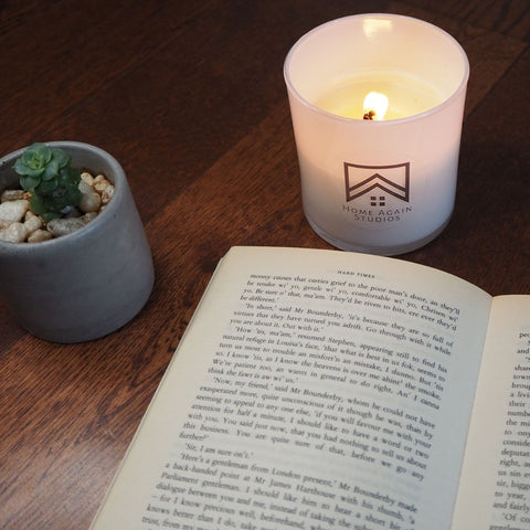 Candle with a book to relax