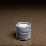 small concrete pot with candle