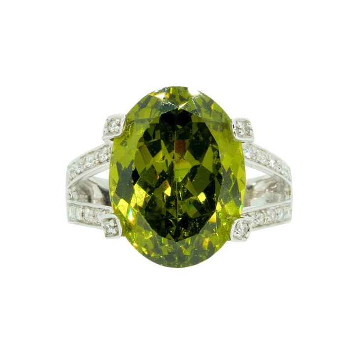 14KT White Gold 15.41ctw Oval Cut Prong Set Peridot And Round Cut Prong Set Diamond Ring - Giorgio Conti Jewelers