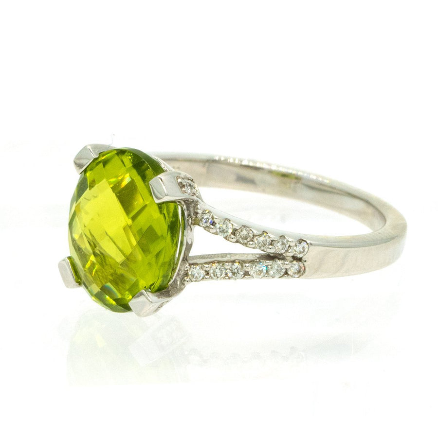 14KT White Gold 3.79ctw Oval Cut Prong Set Peridot And Round Cut Diamond Ring - Giorgio Conti Jewelers