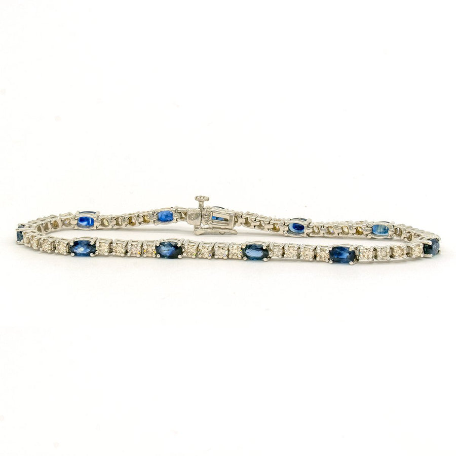 14KT White Gold 5.55CTW Oval Cut Prong Set Sapphire and Diamond Tennis Bracelet - Giorgio Conti Jewelers