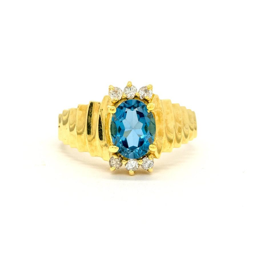 14KT Yellow Gold 1.96CTW Oval Cut Prong Set Blue Topaz and Diamond Ring - Giorgio Conti Jewelers