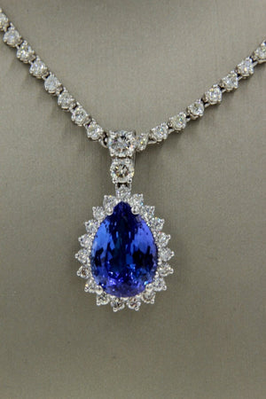 Ladies White Gold Halo Diamond And Tanzanite Pendant - Giorgio Conti Jewelers
