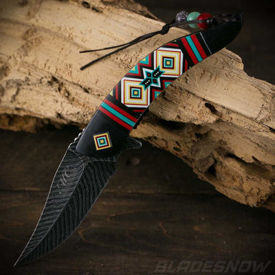 Beautiful black Native American feather spring assisted Knife