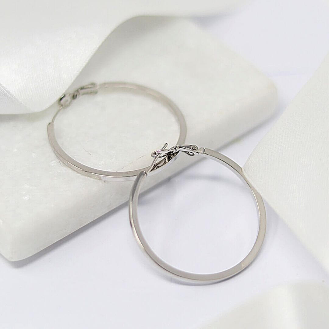 The Lean Hoops White Gold Earrings