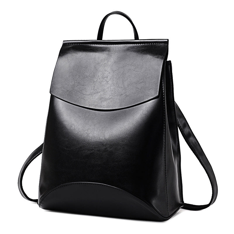 Feminine black slick backpack in PU