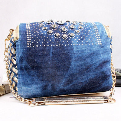 The Denim: Soft Braided Handbag  Be the belle de soiree with this fashionable, lightweight and splendid denim bag decorated with exquisite rhinestones , tassel and chain.Belledesoiree.com