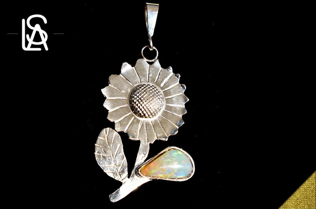 Sunflower, sterling silver pendant  with untreated natural black opal from Honduras