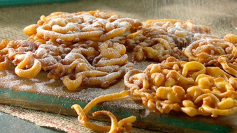 A combination of fried dough and sprinkled with cinnamon and sugar.