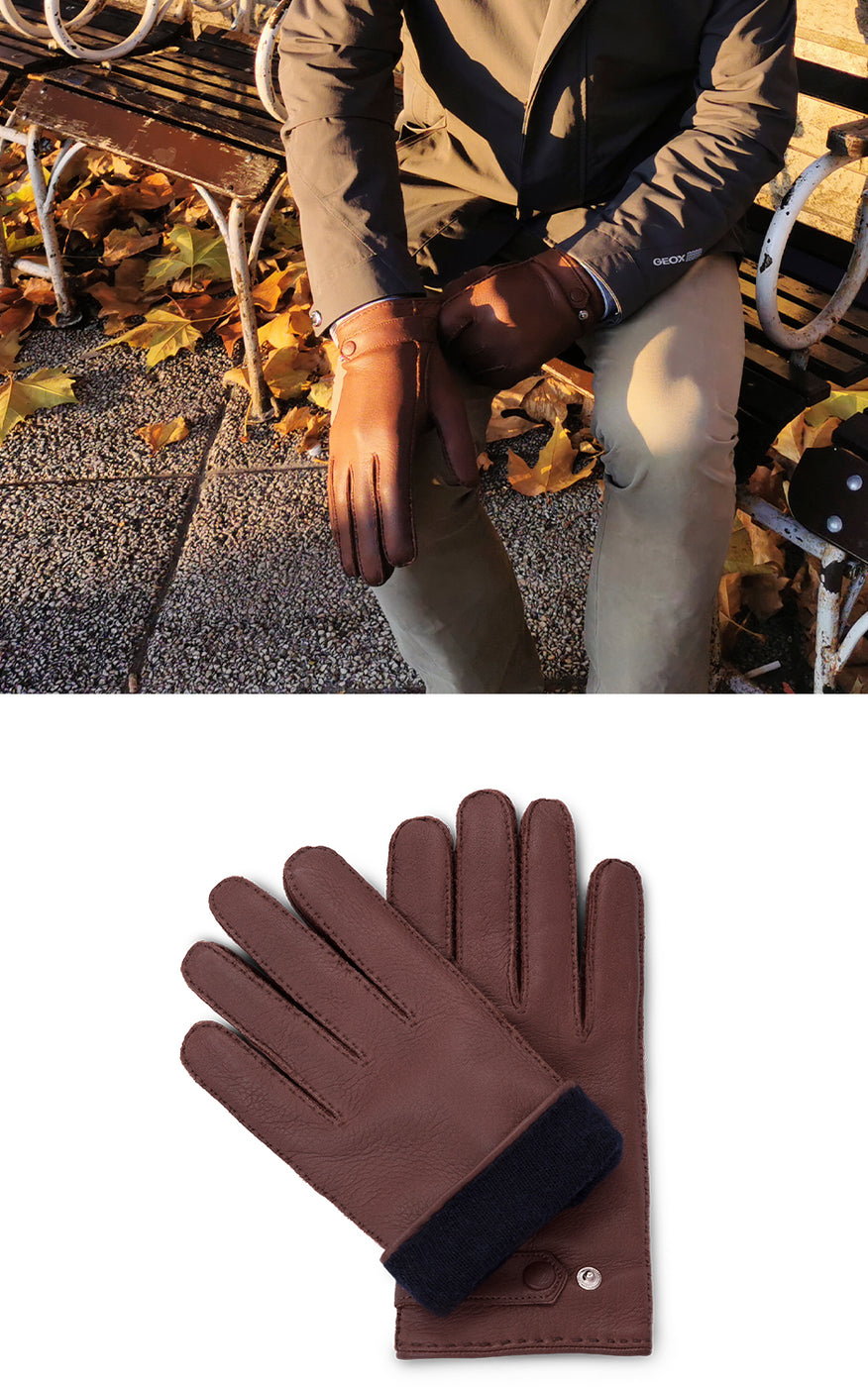 Man wears khaki coat, beige pants and chestnut brown leather gloves