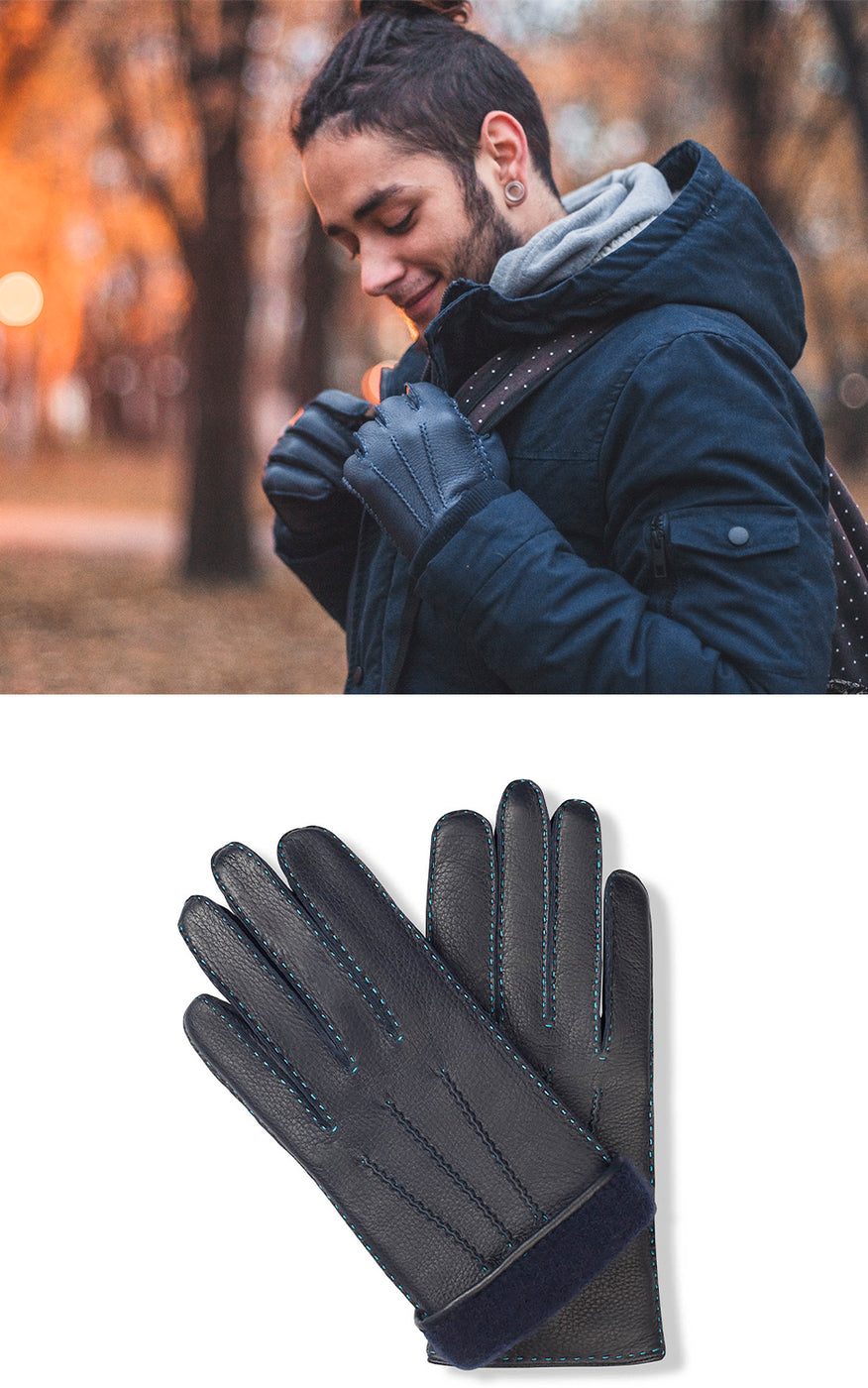 Man wears navy blue coat, backpack and navy blue leather gloves