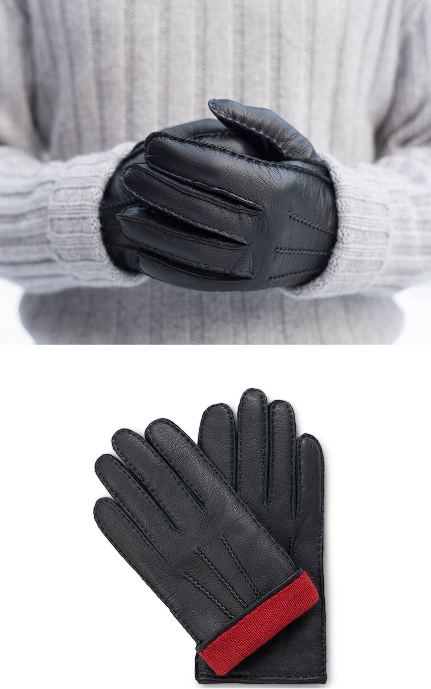 Man in light grey pullover wears black moose leather gloves