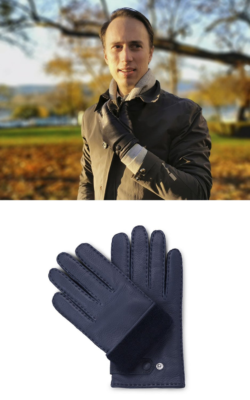 Man wears khaki coat and navy blue leather gloves with navy blue cashmere lining