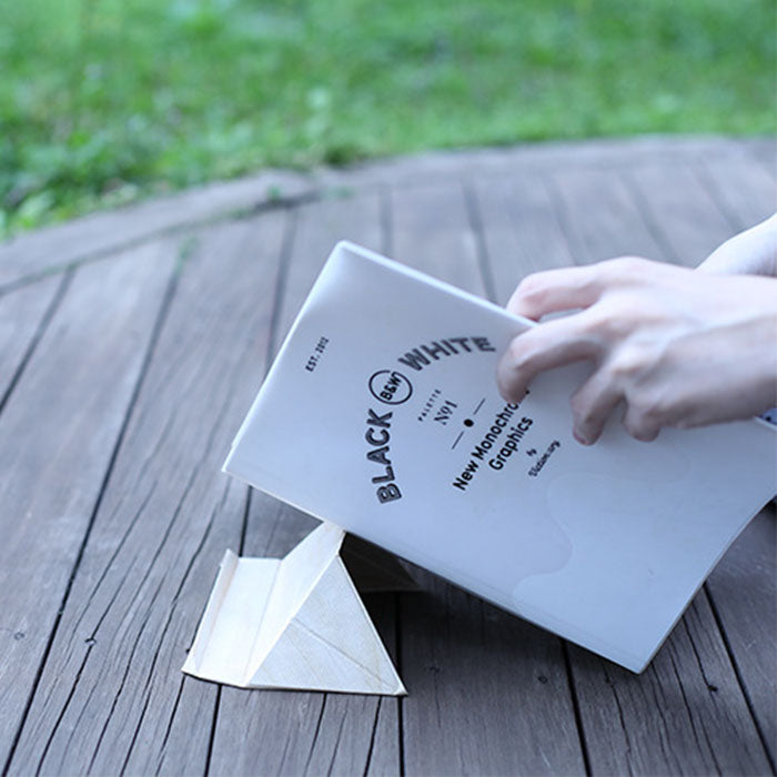 The Flat Origami multi-purpose Stand Single Pack origami structure that can hold your smartphone, laptop, books and more.