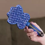 Fairly flat brush for dogs and cats with flexible silicone bristles