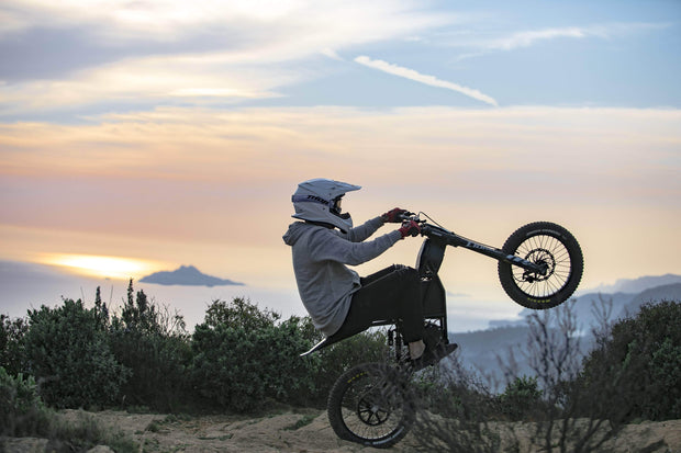 Electric Motorcycle Kuberg Freerider doing a wheelie.