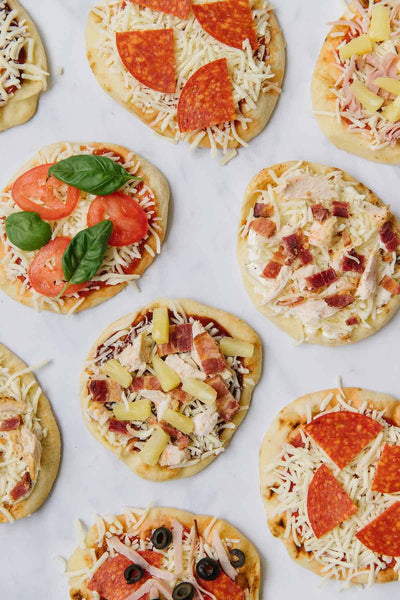 This Mini Naan Pizza is so easy to make, kids won't just love eating them, but they'll love helping to make them, too!