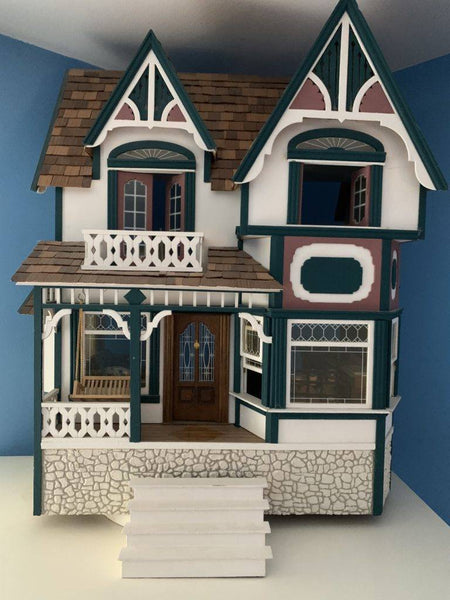 A few years after our oldest daughter was born, my father-in-law built her a beautiful, custom-designed, wooden dollhouse