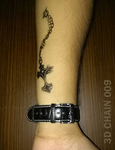 Load image into Gallery viewer, 3D cross chain temporary tattoo on a man's arm.