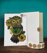 Load image into Gallery viewer, Tintak temporary tattoo sticker with green owl design and roses, with its hard board packaging.