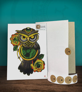 Tintak temporary tattoo sticker with green owl design and roses, with its hard board packaging.