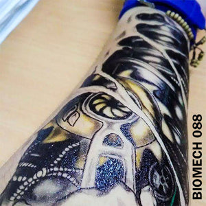 black and gray biomechanical temporary tattoo sticker on man's arm