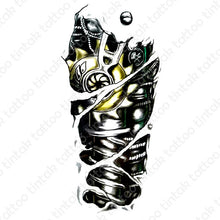 Load image into Gallery viewer, black and gray biomechanical temporary tattoo design with yellow accent on one machine part