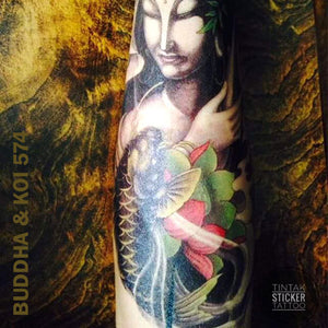 Buddha and Koi Fish temporary tattoo sticker applied in an arm.