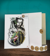 Load image into Gallery viewer, Tintak temporary tattoo sticker with Buddha and koi fish design, with its hard board packaging.