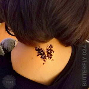 Woman's nape with black butterfly temporary tattoo.