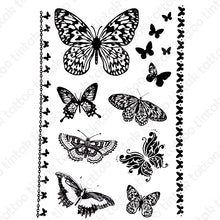 Load image into Gallery viewer, Set of small black butterfly temporary tattoo designs in different variations.