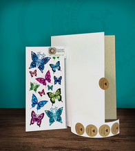 Load image into Gallery viewer, Tintak temporary tattoo sticker with butterfly designs, with its hard board packaging.