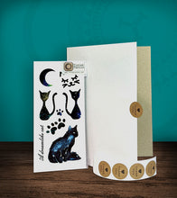Load image into Gallery viewer, Tintak temporary tattoo with cat designs, with its hard board packaging.