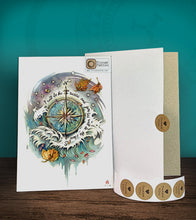 Load image into Gallery viewer, Tintak temporary tattoo sticker with compass and waves design, with its hard board packaging.