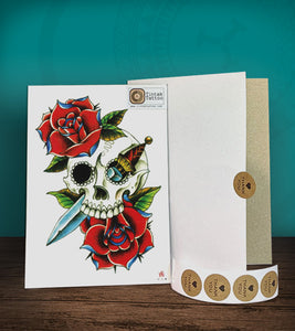 Tintak temporary tattoo sticker with dagger, skull and rose design, with its hard board packaging.