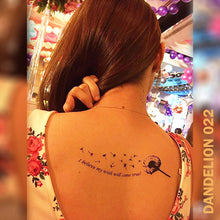 "Load image into Gallery viewer, Woman's back with dandelions flower temporary tattoo sticker and a quote ""I believe my wish will come true""."