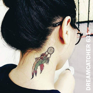 A woman with a small dream catcher temporary tattoo sticker on the right side of her neck.