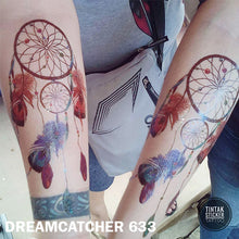 Load image into Gallery viewer, Two arms from a man and a woman showing their dream catcher temporary tattoo sticker.