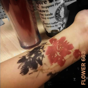 Woman's arm with flower temporary tattoo sticker.