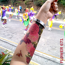 Load image into Gallery viewer, Peony flower temporary tattoo sticker on woman's arm on captured while on the street.
